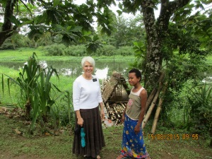 Eleven year old Teema and I by the old raft used to cross the river. It has now been replaced by a good boat