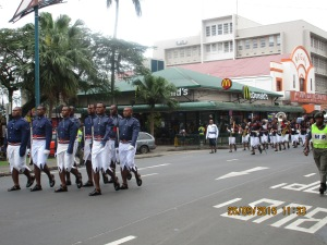 The parade even had a band, seen here marching past one of Fiji's three McDonald's restaurants.