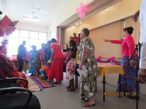 The ceremonial handover of colorful cushions, pillow and mattress covers sewn by the Relief Society sisters.