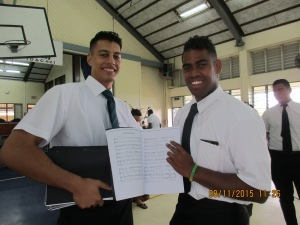 James, our fearless choir leader, and Tomasi, holding the choir books James put together for the YSAs