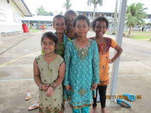 Izell and her friends playing in their Indian dresses